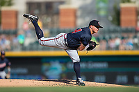 Gwinnett Braves starting pitcher Kris Medlen (54) follows through on his delivery against the Charlotte Knights at BB&T BallPark on July 16, 2017 in Charlotte, North Carolina.  The Knights defeated the Braves 5-4.  (Brian Westerholt/Four Seam Images)
