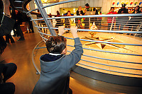 Dec. 30, 2009 - San Francisco, California, USA - A boy watches a large penjeum swing at the California California Academy of Sciences Natural History Museum in San Francisco Wednesday December 30, 2009. (Photo by Alan Greth)