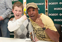 "16/03/2012 Sugar Ray Leonard signs a copy of his book for Ian Fox (11) from Trim during a book signing of his autobiography ""The Big Fight"" at Eason's Bookstore, Dublin. Photo: Collins Photos"