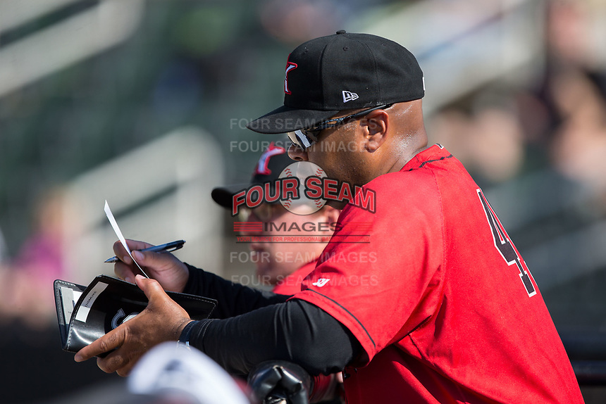 Kannapolis Intimidators hitting coach Jamie Dismuke (45) makes notes during the game against the Hagerstown Suns at Kannapolis Intimidators Stadium on June 14, 2017 in Kannapolis, North Carolina.  The Intimidators defeated the Suns 4-1 in game one of a double-header.  (Brian Westerholt/Four Seam Images)
