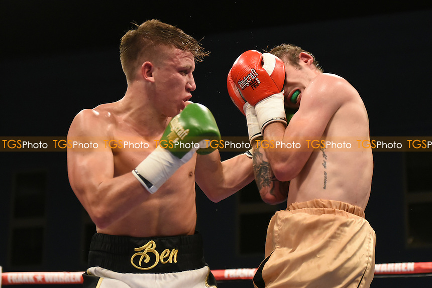 Ben Smith (white/black shorts) defeats Chris Adaway during a Boxing Show at the Harrow Leisure Centre on 8th October 2016