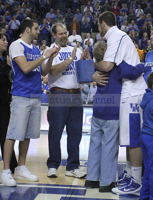 Josh Harrellson hugged family members during the Senior Day events on Tuesday, March 1, 2011. Photo by Latara Appleby   Staff
