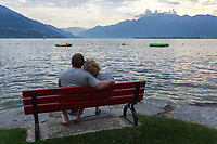 Switzerland. Canton Ticino. Tenero. Camping Campofelice. A loving couple enjoys the view at sunset on Lago Maggiore's shores. Lake Maggiore (Lago Maggiore) or Lago Verbàno is the largest lake in southern Switzerland.20.07.2018 © 2018 Didier Ruef