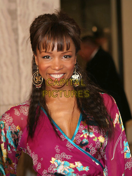 "ELISE NEAL.""Something New"" Los Angeles Premiere held at The Cinerama Dome, Hollywood, California..January 24th, 2006.Photo: Zach Lipp/AdMedia/Capital Pictures.Ref: ZL/ADM.headshot portrrait gold hoop butterfly earrings.www.capitalpictures.com.sales@capitalpictures.com.© Capital Pictures."