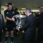 Carl Hayman hands the Bledisloe Cup to coach Graham Henry after the All Blacks v Australia Philips Tri Nations Test match. Eden Park, Auckland, New Zealand. Saturday 21 July 2007.