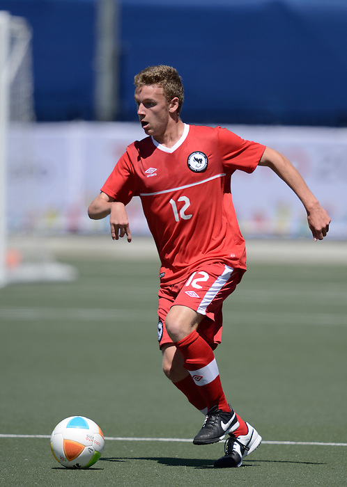 Toronto, ON - Aug 9 2015 -  Nick Heffernan carries the ball as Canada takes on the United States in the First Round of Football 7-a-side at the Parapan Am Fields during the Toronto 2015 Parapan American Games  (Photo: Matthew Murnaghan/Canadian Paralympic Committee)