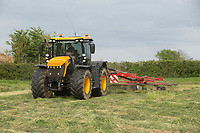 Contractors raking grass silage<br /> &copy;Tim Scrivener Photographer 07850 303986<br /> ....Covering Agriculture In The UK....