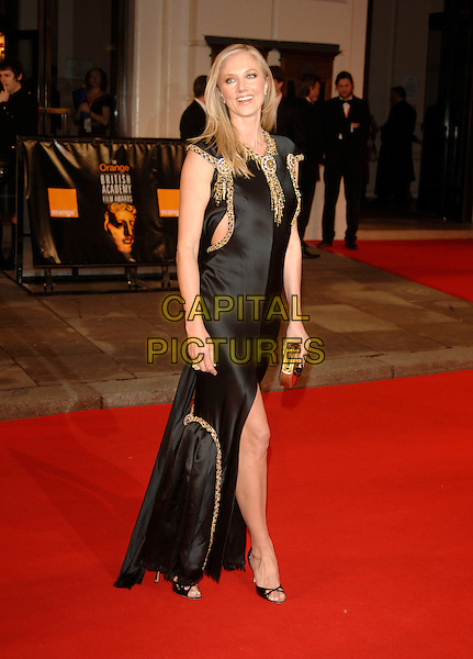 JOELY RICHARDSON.Red Carpet Arrivals at The Orange British Academy Film Awards (BAFTA's) held at the Royal Opera House, Covent Garden, London, England, February 11th 2007..full length black dress leg slit split gold joley.CAP/PL.©Phil Loftus/Capital Pictures