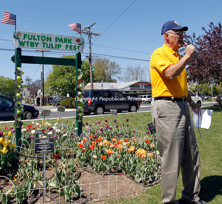 """Waterbury, CT-29 April 2012-042912CM03-   Dominic Rinaldi, director of the Waterbury Tulip and Flower Festival  says opening remarks during the second annual event Sunday morning at Fulton Park.  Rinaldi said he expects 400-500 people this year, more than last year.  Rinaldi said he has a vision for Fulton Park to resemble the Keukenhof gardens, a renown park in Holland.  Rinaldi said with the collective effort of the Historic Overlook Community Club, who has been spearheading a cleanup effort, he hopes reach that vision.  Rinaldi said the park would look """"majestic"""".      Christopher Massa Republican-American"""