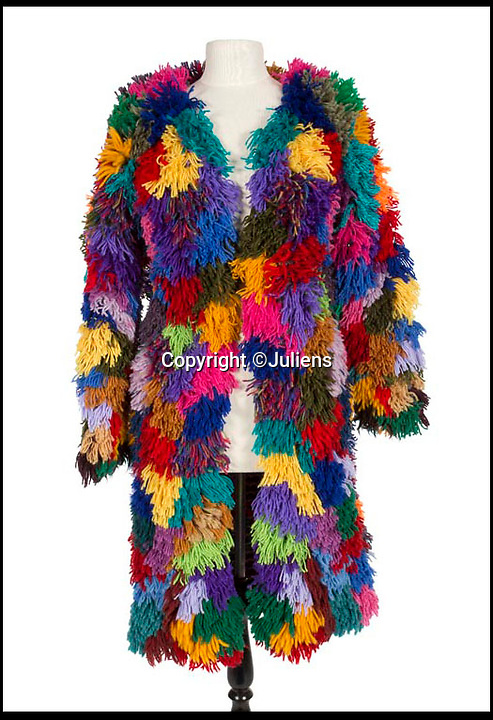 BNPS.co.uk (01202 558833)Pic: Juliens/BNPS<br /> <br /> Mitchell's 1960s multicoloured shag coat. The coat ws worn by Mitchell to parties and social events.<br /> <br /> An enormous collection of items belonging to the late drummer Mitch Mitchell has emerged for sale.<br /> <br /> The star, who died at the age of 67 in 2008, was best known for his work with Jimmy Hendrix Experience between 1966 and 1970.<br /> <br /> Now his family have decided to sell a large amount of his personal items as they feel they can no longer handle the responsibility and want to see them go to a good home.<br /> <br /> The collection is made up of countless instruments, shirts, posters and documents - many of which are previously unseen.<br /> <br /> The items offer a gateway to a different time with some incredibly outlandish and psychedelic lots perfectly encapsulating London in the 60s.<br /> <br /> Among them is a multi coloured, patchwork shaggy coat which Mitchell would often wear to parties.<br /> <br /> The coat hangs below the waist and looks more like a rug from Austin Powers front room than a sophisticated dinner jacket.