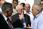 Palestinian prime minister Salam Fayyad (R),the mayor of Bethlehem (C) and governor of Hebron dr. hossin al- a`araj (L) during the opening  the water project and the hole Rashaida Arabs and the line carrier and the electrical link to the wells in the province of Bethlehem in Rashaida Arabs village near the West Bank town of Bethlehem, Sunday, July 19, 2009.  Photo by Najeh Hashlamoun