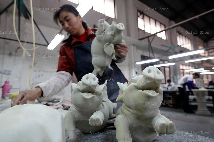 Workers make petroleum resin based gift items and garden ornaments at the Chuan Sen Art & Design Factory on the outskirts of Guangzhou, in Guangdong Province, China on 04 February, 2009.  Orders at the factory, who sells almost all of their wares in North America and Europe, has declined drastically in the last two years.
