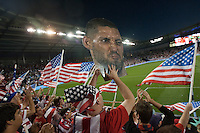 A fan of the United States Men's National Team holds up a face of Clint Dempsey while playing against Guatemala at Livestrong Sporting Park in Kansas City, Kansas in a World Cup Qualifier on Tue. Oct. 16, 2012.
