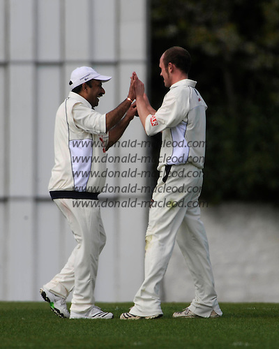 Scottish National Cricket League - Grange V Uddingston at Reaburn Place, Edinburgh - Opening match of the new season for last years Champions hosting Uddy - Uddingston bowler Imran Adrees and David Bill (right) celebrate as their 5 wickets (incl Bill's 3 wickets for 6 runs off 4 overs) skittled the home side out for 147 - Picture by Donald MacLeod 1 May 2009