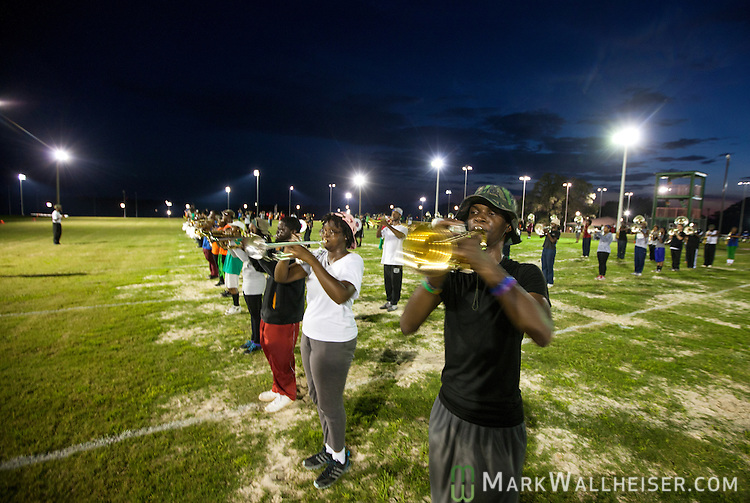 TALLAHASSEE, FL - SEPTEMBER 5, 2013:   <br /> Emani Booker (right), a freshman from Decatur, GA, and his bandmates in the FAMU Marching 100 band practices at night on the Florida A&amp;M University campus.