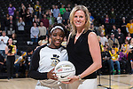 Wake Forest Demon Deacons head coach Jen Hoover presents Amber Campbell (2) with a ball prior to the start of the game against Georgia Tech Yellow Jackets to commemorate her 1,000 career point at the LJVM Coliseum on January 22, 2017 in Winston-Salem, North Carolina.   (Brian Westerholt/Sports On Film)