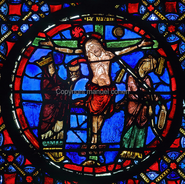 Crucifixion, with Christ on the cross flanked by Ecclesia and Synagoga, from the stained glass window of the New Alliance, 1215-25, in bay 3, in the ambulatory of Bourges Cathedral or the Cathedrale Saint-Etienne de Bourges, built 1195-1230 in French Gothic style and consecrated in 1324, in Bourges, Centre-Val de Loire, France. The New Alliance window is a typological window, drawing parallels between the Old and New Testaments, specifically with the Passion scenes of Christ carrying the cross, the Crucifixion and the Resurrection with their Old Testament antetypes. 22 of the original 25 medieval stained glass windows of the ambulatory have survived. The cathedral is listed as a UNESCO World Heritage Site. Picture by Manuel Cohen