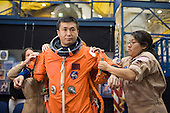 Houston, TX - (FILE) -- File photo dated December 22, 2008. Japan Aerospace Exploration Agency (JAXA) astronaut Koichi Wakata, STS-119 mission specialist, gets help in the donning of a training version of his shuttle launch and entry suit in preparation for a training session in the Space Vehicle Mock-up Facility at NASA's Johnson Space Center. Wakata is scheduled to join Expedition 18 as flight engineer after launching to the International Space Station with the STS-119 crew..Credit: James Blair - NASA via CNP