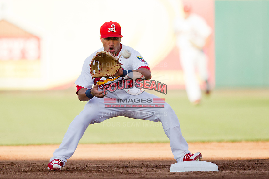 Kolten Wong (4) of the Springfield Cardinals catches a ball to turn a double play during a game against the Northwest Arkansas Naturals at Hammons Field on June 14, 2012 in Springfield, Missouri. (David Welker/Four Seam Images)