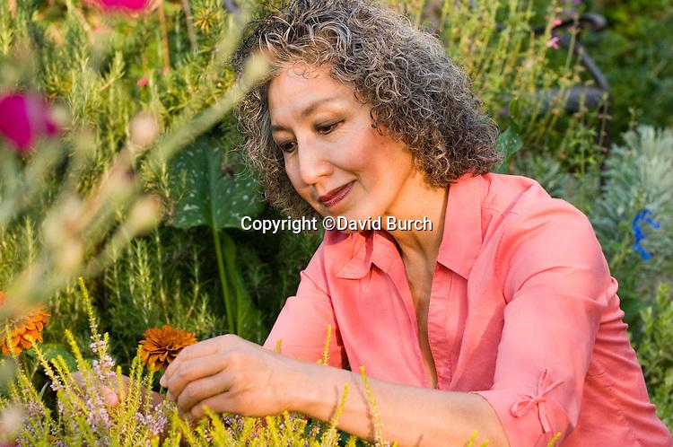 Asain woman working in her garden