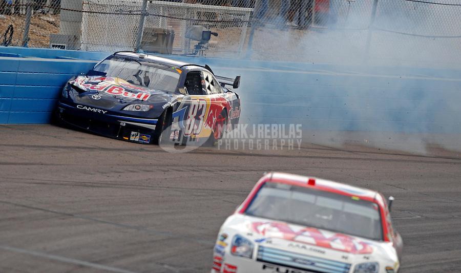 Nov. 9, 2008; Avondale, AZ, USA; NASCAR Sprint Cup Series driver Brian Vickers hits the wall during the Checker Auto Parts 500 at Phoenix International Raceway. Mandatory Credit: Mark J. Rebilas-