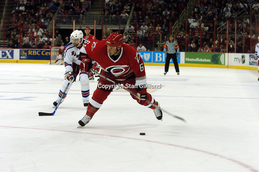 Carolina Hurricanes' Cory Stillman shoots to score a last minute goal against the New York Rangers Tuesday, March 14, 2006 at the RBC Center in Raleigh, NC. Carolina won 5-3.