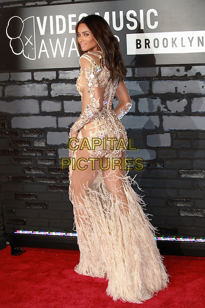 Ciara (Ciara Princess Harris)<br /> 2013 MTV Video Music Awards held at The Barclays Center, Brooklyn, New York, USA.<br /> August 25th, 2013<br /> full length white silver sheer feather sheer embellished jewel encrusted see through thru dress  back behind rear looking over shoulder VMA VMAS<br /> CAP/ADM/MPI/C99<br /> &copy;C99/MPI/AdMedia/Capital Pictures