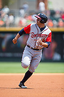 Matt Tuiasosopo (5) of the Gwinnett Braves keeps his eye on the baseball as he hustles towards third base during the game against the Charlotte Knights at BB&T BallPark on May 22, 2016 in Charlotte, North Carolina.  The Knights defeated the Braves 9-8 in 11 innings.  (Brian Westerholt/Four Seam Images)