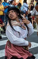 Lima, Peru.  Young Woman Marching in an Andean Cultural Parade, Plaza de Armas.