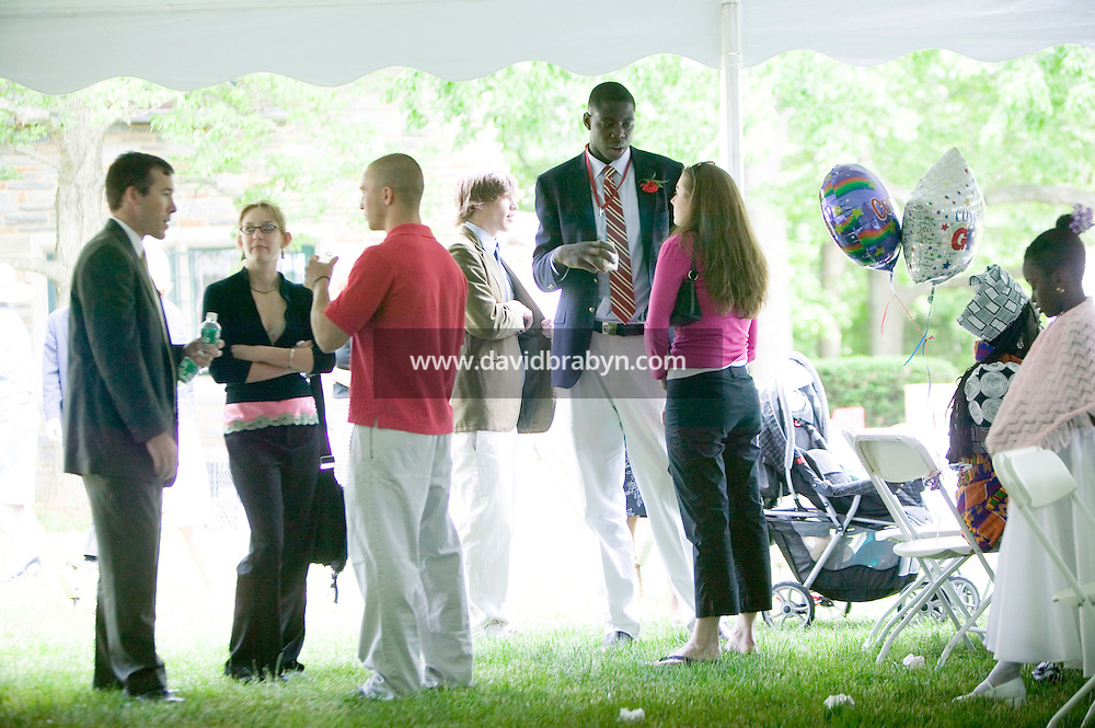 Eric Boateng (5L) talks to friends during the reception for his final year Commencement ceremony at St Andrews High School in Middletown, DE, United States, 29 May 2005.
