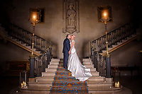 A beautiful photograph of the bride and groom on the magnificent staircase at Ashridge House