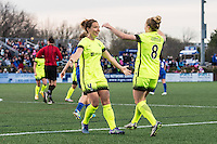 Allston, MA - Sunday, April 24, 2016: Seattle Reign FC defender Rachel Corsie (4) and midfielder Kim Little (8) celebrate Corsie's goal. The Boston Breakers play Seattle Reign during a regular season NSWL match at Harvard University.