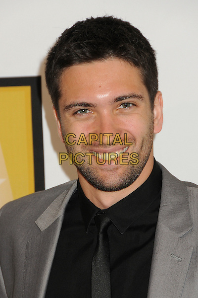 Dmitry Chaplin.1st Annual Critics' Choice Television Awards held at The Beverly Hills Hotel, Beverly Hills, California, USA, .20th June 2011..portrait headshot shirt tie smiling beard facial hair stubble  grey gray jacket black.CAP/ADM/BP.©Byron Purvis/AdMedia/Capital Pictures.