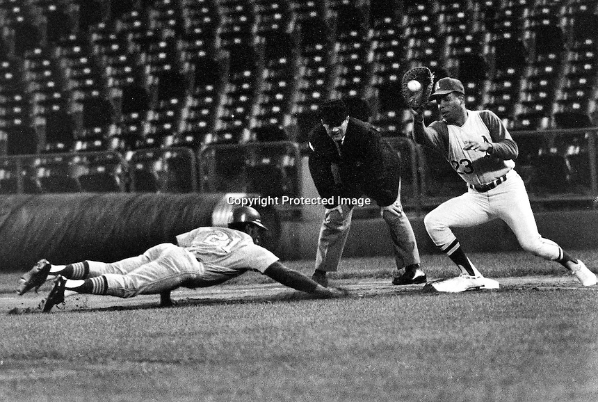 Tommy Harper dives back to first base, A's Ramon Webster takes throw. (1969 photo by Ron Riesterer)