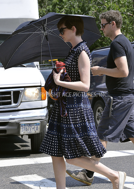 WWW.ACEPIXS.COM<br /> <br /> June 24 2013, New York City<br /> <br /> Actress Anne Hathaway on the set of the new movie 'Song One' on June 24 2013 in New York City<br /> <br /> By Line: Curtis Means/ACE Pictures<br /> <br /> <br /> ACE Pictures, Inc.<br /> tel: 646 769 0430<br /> Email: info@acepixs.com<br /> www.acepixs.com