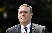 United States Secretary of State Mike Pompeo listens as US President Donald Trump speaks to the press after meeting with Kim Yong Chol, former North Korean military intelligence chief and one of leader Kim Jong Un's closest aides, on the South Lawn of the White House in Washington on Friday, June 1, 2018. <br /> Credit: Olivier Douliery / Pool via CNP