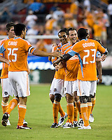 Houston Dynamo players Bobby Boswell (32), Brian Ching (25), Ricardo Clark (13), and Dominic Oduro (23) celebrate with Brad Davis after his goal.  Houston Dynamo defeated D.C. United 4-3 at Robertson Stadium in Houston, TX on August 1, 2009.