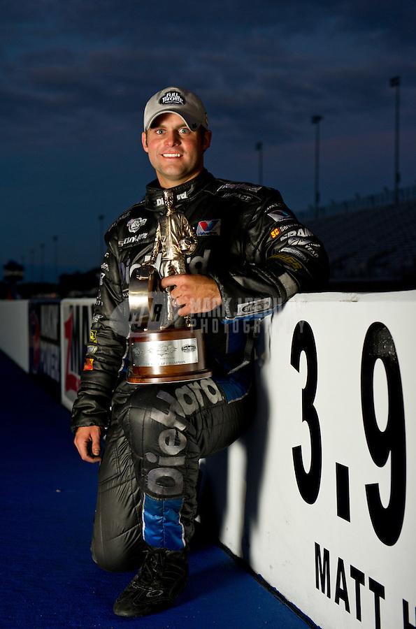 Sept. 18, 2011; Concord, NC, USA: NHRA funny car driver Matt Hagan poses for a portrait after winning the O'Reilly Auto Parts Nationals at zMax Dragway. Mandatory Credit: Mark J. Rebilas-