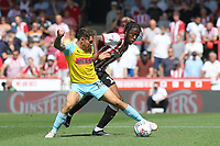 Jon Taylor of Rotherham shields the ball from Brentford's Romaine Sawyers during Brentford vs Rotherham United, Sky Bet EFL Championship Football at Griffin Park on 4th August 2018
