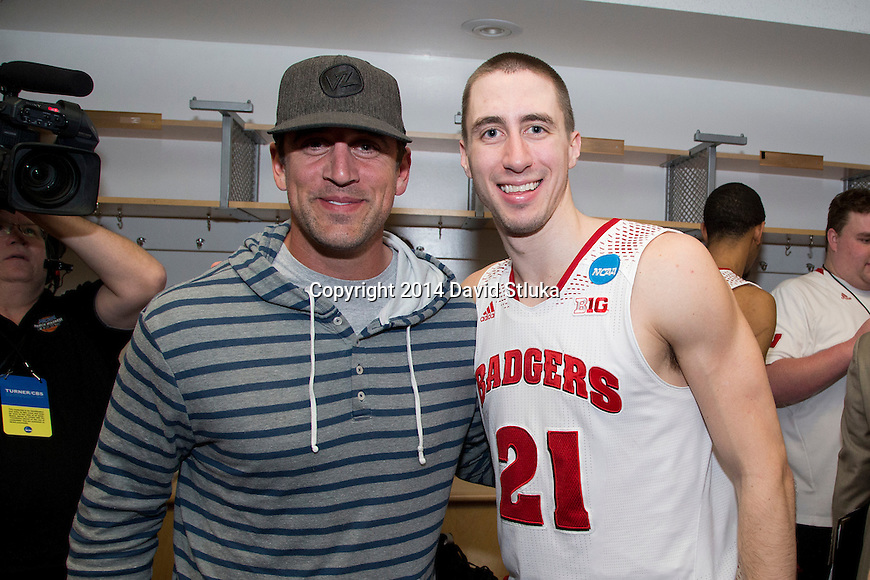 Wisconsin Badgers Josh Gasser (21) poses with Green Bay Packers quarterback Aaron Rodgers after  a regional semifinal NCAA college basketball tournament game against the Baylor Bears Thursday, March 27, 2014 in Anaheim, California. The Badgers won 69-52. (Photo by David Stluka)