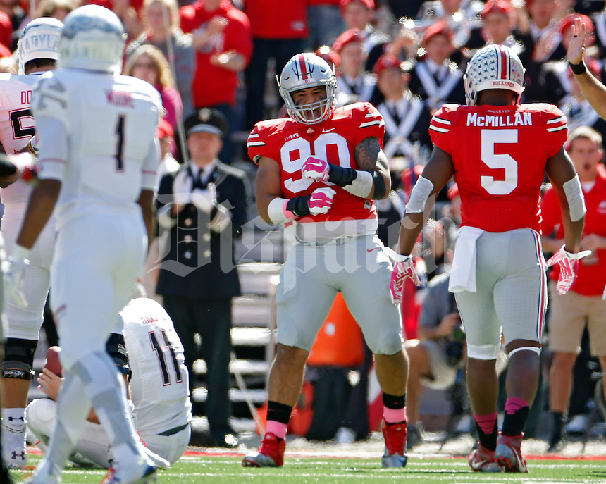 Ohio State Buckeyes defensive lineman Tommy Schutt (90) celebrate a tackle of Maryland Terrapins quarterback Perry Hills (11) in the second quarter of their game in Ohio Stadium on October 10, 2015.  (Dispatch photo by Kyle Robertson)