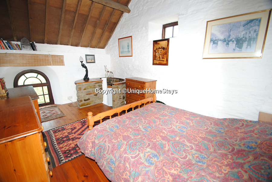 BNPS.co.uk (01202 558833)Pic: UniqueHomeStays/BNPS<br /> <br /> Before the Chapel's renovation...<br /> <br /> Praise the Lord...stunning former Chapel on the remote north coast of Cornwall is now a romantic bolthole.<br /> <br /> The former Methodist chapel on the historic Trevalga estate has now been turned into a heavenly holiday let with spectacular sea views can be rented for up to £2500 a week.<br /> <br /> The owners have given it a makeover with a nod to its ecclesiastical past, combining upcycled church pews and a lectern that compliment the arched and stained glass windows, alongside sumptuous furnishings and original artwork.<br /> <br /> As well as having stylish interiors, the quirky holiday home is perfectly placed - the historic Tintagel, linked to the legend of King Arthur, is to the left and the picturesque fishing port of Boscastle is to the right.