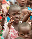 A girl points as she and other students sing while they gather in the morning at the Catholic Church-sponsored Abangite Nursery School in Yambio, South Sudan.