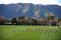 The team warms up during the 2017 DHL Lions Series All Blacks rugby training session at Hutt Rec in Lower Hutt, New Zealand on Tuesday, 27 June 2017. Photo: Dave Lintott / lintottphoto.co.nz