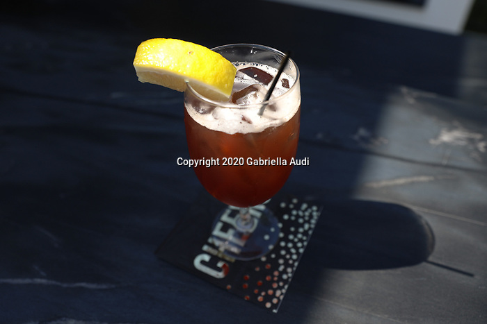 June 20, 2020: The Belmont Jewel, signature drink of the Belmont Stakes, is served at the watch party hosted by the owners of Sole Volante. Gabriella Audi/Eclipse Sportswire/CSM