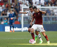 Calcio, Serie A: Roma vs Juventus. Roma, stadio Olimpico, 30 agosto 2015.<br /> Roma&rsquo;s Miralem Pjanic, right, is challenged by Juventus&rsquo; Simone Padoin during the Italian Serie A football match between Roma and Juventus at Rome's Olympic stadium, 30 August 2015.<br /> UPDATE IMAGES PRESS/Isabella Bonotto