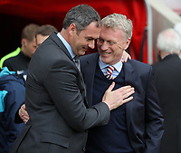 (L-R) Swansea manager Paul Clement greeted by Sunderland manager David Moyes during to the Premier League match between Sunderland and Swansea City at the Stadium of Light, Sunderland, England, UK. Saturday 13 May 2017