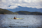 ALASKA, Ketchikan, a kayaker in the water off the Behm Canal near Clarence Straight, Knudsen Cove along the Tongass Narrows