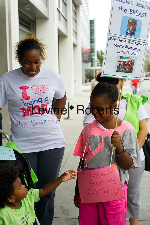Sahnjae Brecee, age seven years carries a sign promoting breastfeeding.  Breastfeeding mothers and their supporters participate in a subway caravan to promote breastfeeding and to celebrate World Breastfeeding Week, In New York on Friday, August  10, 2012.   NYC Mayor Michael Bloomberg recently announced that city hospitals will be promoting breastfeeding and discouraging the use of formula.  (© Frances M. Roberts)