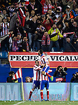 Atletico Madrid's midfielder Mario Suarez (C) celebrates his goal with teammates during the round of 16 second leg UEFA Champions League football match Atletico de Madrid vs Bayern Leverkusen at the Vicente Calderon stadium in Madrid on March 17, 2015.  PHOTOCALL3000/ DP